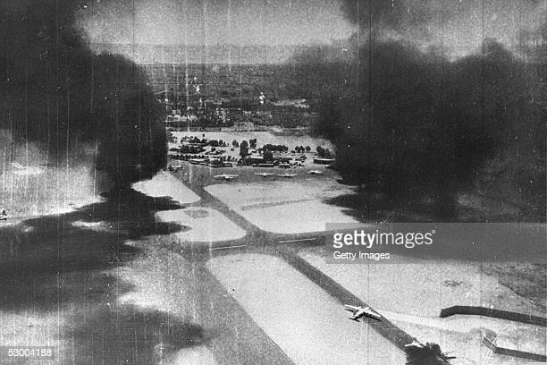 Smoke rises from destroyed Egyptian airplanes during an Israeli Air Force preemptive strike on June 5 1967 against Egyptian airfields at the start of...
