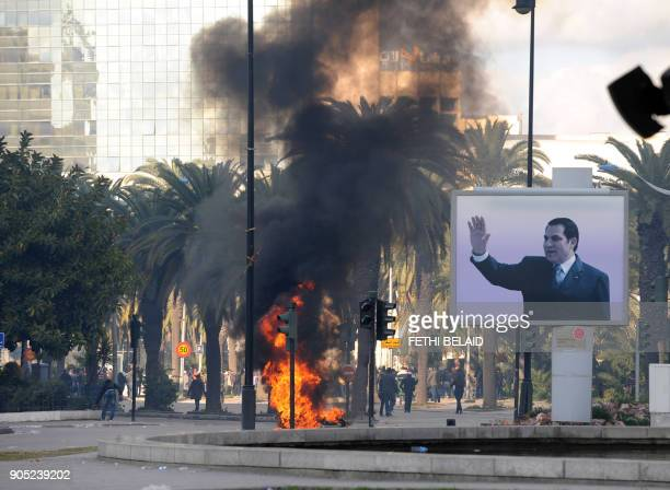 Smoke rises from fire left after clashes between security forces and demonstrators in Tunis on January 14 2011 after Tunisian President Zine El...