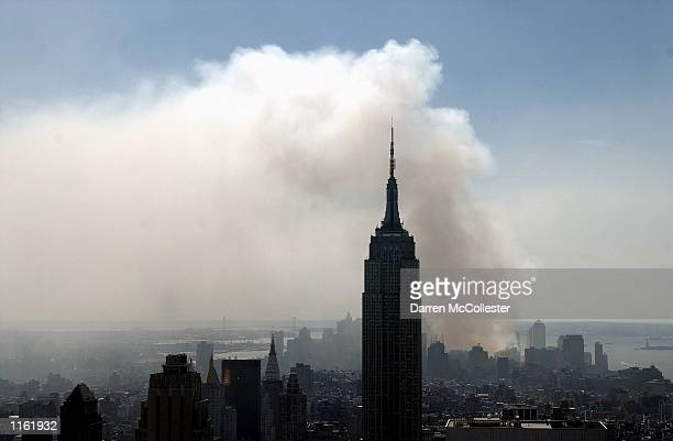 Smoke rises from fires still smolders at the World Trade Center September 12 2001 in New York City A terrorist attack on the Twin Towers reduced the...
