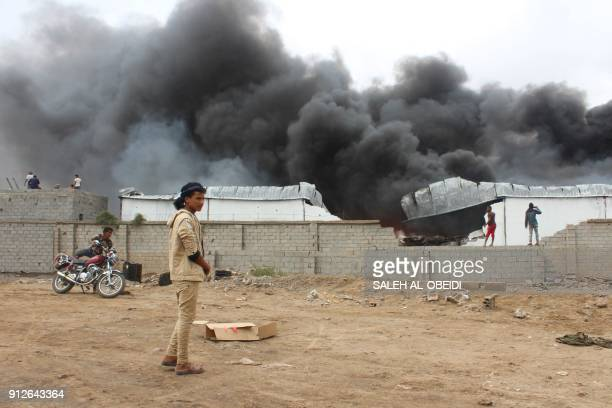 Smoke rises from inside a military camp the day after fighters from the separatist Southern Transitional Council took control of the progovernment...