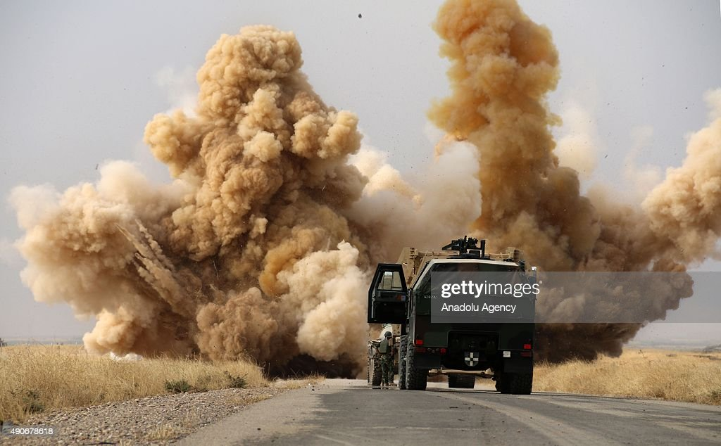 Smoke rises from minefield in Telelverid region after Peshmerga forces detonated landmines placed by DAESH forces to intervene the passing of Peshmergas during an operation against Daesh terrorists in the outskirts of Kirkuk, Iraq on September 30, 2015. 10 villages rescued from Daesh terrorists.