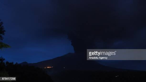 Smoke rises from Mount Agung in Rendang village of Karangasem regency 7 kilometers from the erupted Mount Agung in Bali Indonesia on November 26 2017...