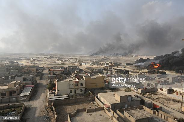 Smoke rises from oil wells were set on fire by Daesh terrorists to limit coalition forces pilots' eyesight and to make the wells out of service...