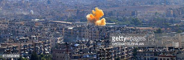 Smoke rises from reported opposition fire from buildings in an eastern governmentheld neighbourhood of the northern Syrian city of Aleppo on October...