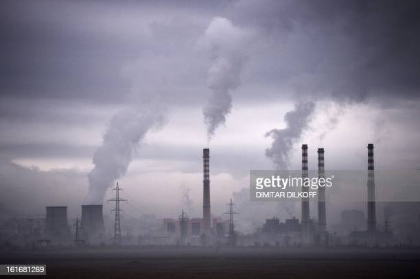 Smoke rises from stacks of a thermal power station in Sofia on February 14 2013 / AFP / DIMITAR DILKOFF