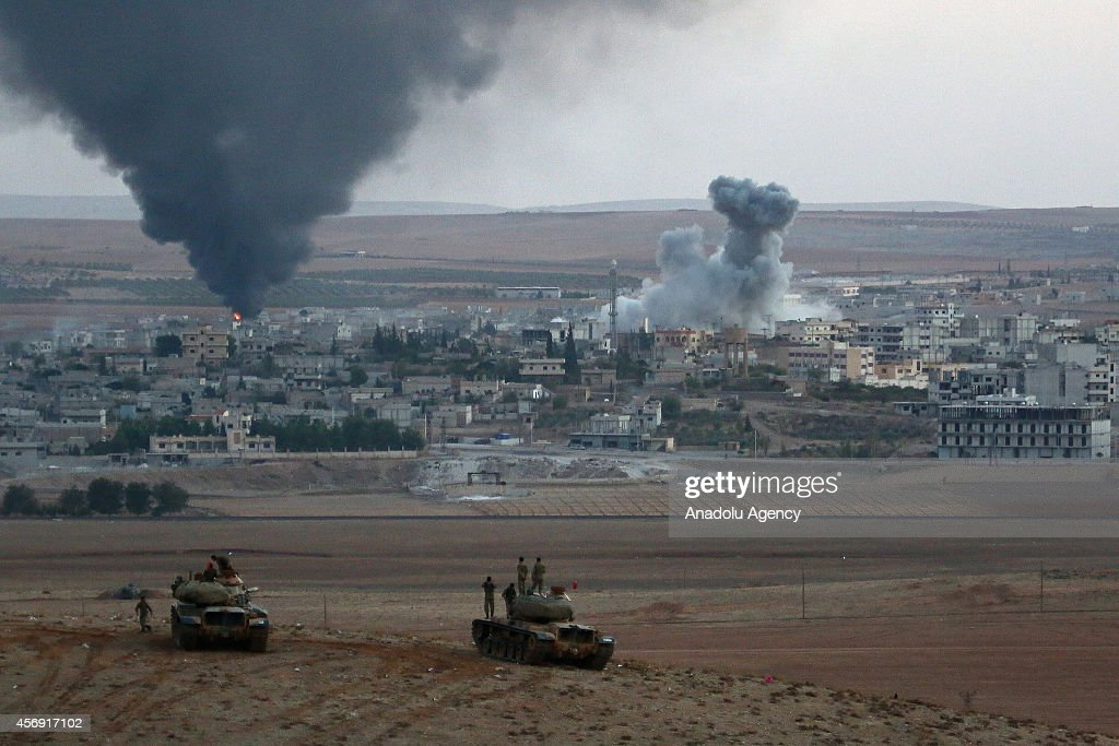 Smoke rises from Syria's Ayn al-Arab city (Kobani) after the shelling at the clashes between the Islamic State of Iraq and the Levant (ISIL) and Kurdish armed groups in Ayn al-Arab city on October 9, 2014.