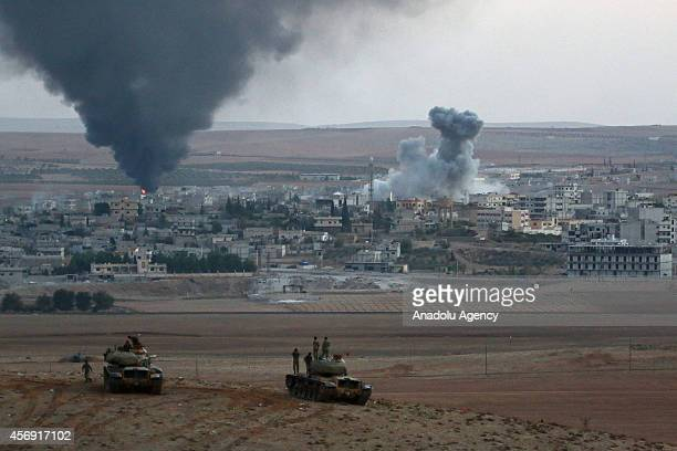 Smoke rises from Syria's Ayn al-Arab city after the shelling at the clashes between the Islamic State of Iraq and the Levant and Kurdish armed groups...