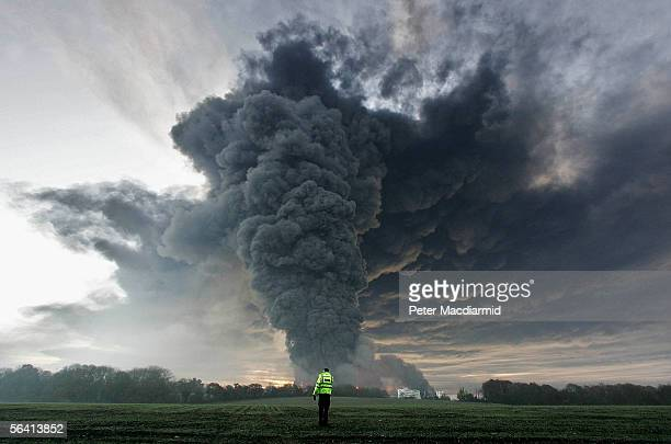 Smoke rises from the a fire at the Buncefield fuel depot on December 11 2005 in Hemel Hemstead England The explosions are being treated as accidental...