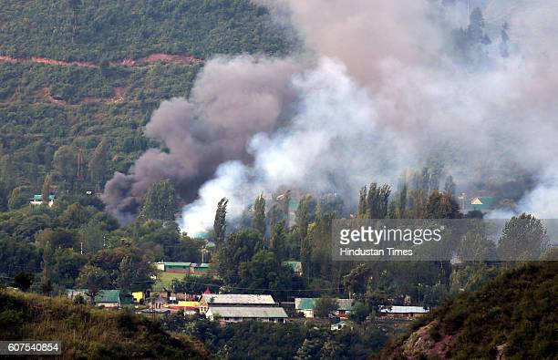 Smoke rises from the army base which was attacked by militants in the town of Uri west of Srinagar on September 18 2016 in Srinagar India The attack...