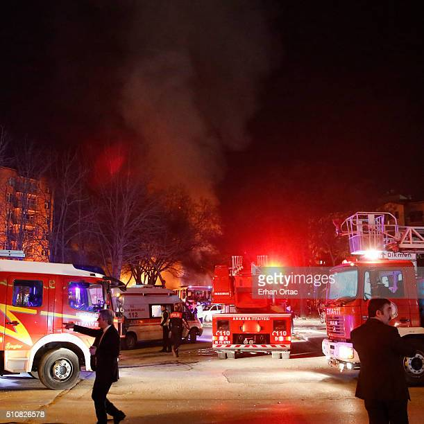 Smoke rises from the blast site as Turkish army busses burn after an explosion on February 17 2016 in Ankara Turkey At least five people have been...