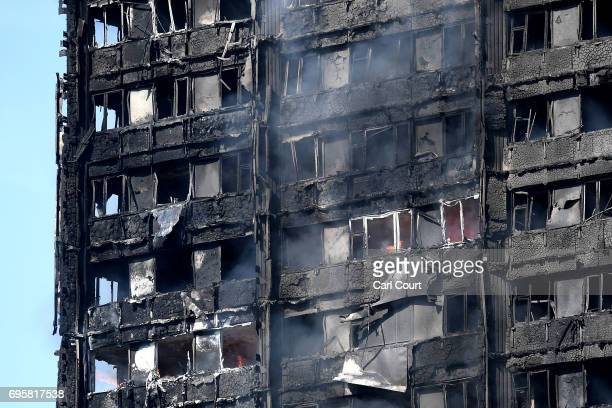 Smoke rises from the burning 24 storey residential Grenfell Tower block in Latimer Road West London on June 14 2017 in London England The Mayor of...