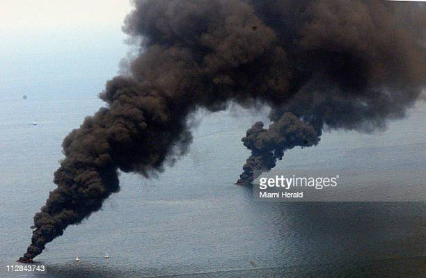 Smoke rises from the burning of oil caught on the surface at the site of the Deepwater Horizon rig accident on Saturday June 19 2010