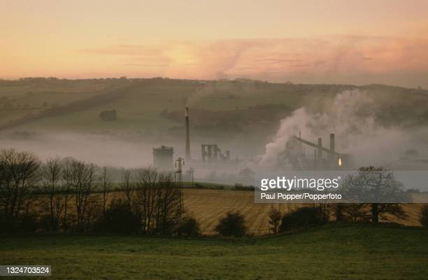 Smoke rises from the coke ovens at Derwenthaugh Coke Works next to the River Derwent near Gateshead, England in January 1986. Coke from the plant is...
