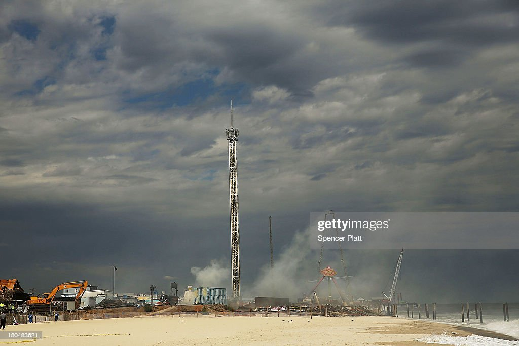 Smoke rises from the destroyed remains of businesses along an iconic Jersey shore boardwalk on September 13, 2013 in Seaside Heights, New Jersey. The 6-alarm fire began in a frozen custard stand on the recently rebuilt boardwalk around 2:00 p.m. on September 12, and quickly spread in high winds. While there were no injuries reported, many businesses that had only recently re-opened after Hurricane Sandy, were destroyed in the blaze.