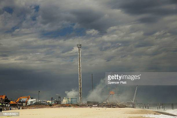 Smoke rises from the destroyed remains of businesses along an iconic Jersey shore boardwalk on September 13 2013 in Seaside Heights New Jersey The...