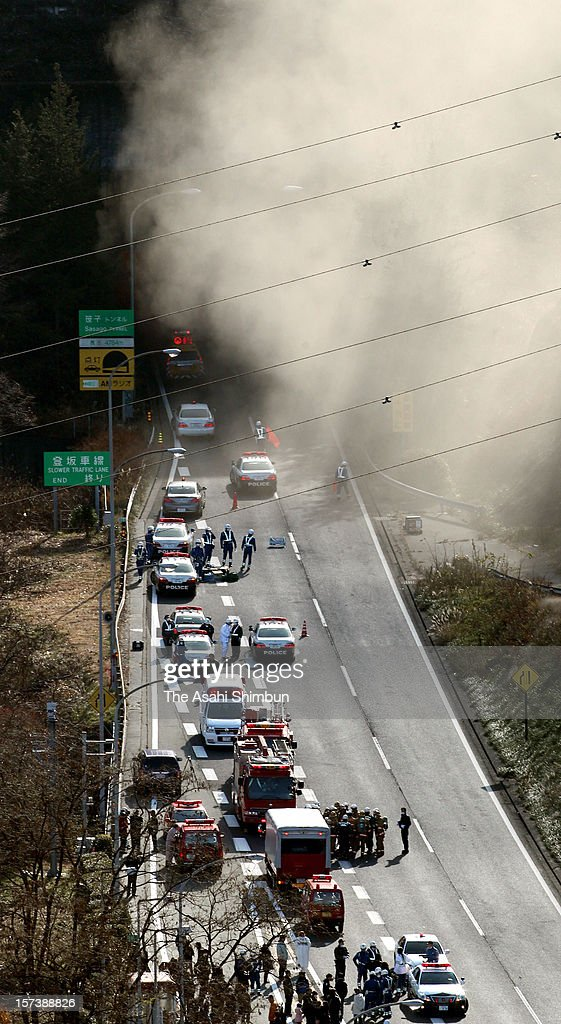 Smoke rises from the entrance of Sasago Tunnel of the Chuo expressway on December 2, 2012 in Otsuki, Yamanashi, Japan. The concrete ceiling panels of the tunnel collapsed more than 110 metres and at least 9 people confirmed dead.