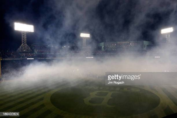 Smoke rises from the field during a celebration after the Boston Red Sox defeated the St Louis Cardinals 61 in Game Six of the 2013 World Series at...