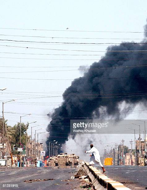 Smoke rises from the horizon during clashes between militia loyal to the radical Shiite cleric Moqtada al-Sadr and U.S troops August 28, 2004 in the...
