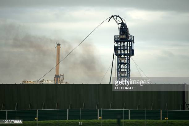 Smoke rises from the Preston New Road drill site where energy firm Cuadrilla Resources have commenced fracking operations to extract shale gas near...