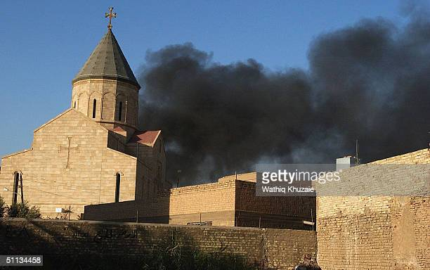 Smoke rises from the scene of a car bomb targeting a church in the Karradah district on August 1 2004 in Baghdad Iraq Car bombs exploded outside at...