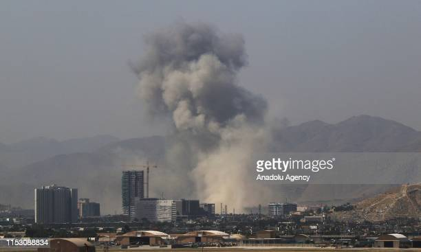 Smoke rises from the scene of a suicide bombing in Kabul Afghanistan July 01 2019 At least 10 people were killed and 65 more injured in a suicide...