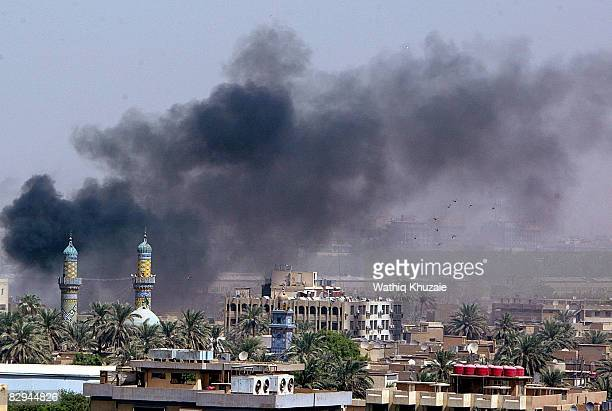 Smoke rises from the site of a car bomb explosion on September 22 2008 in Karrada district in Baghdad Iraq The bomb killed at least one and wounded...