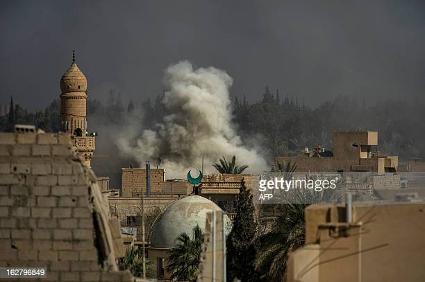 Smoke rises from the site of a missile attack in Hawiqah neighbourhood in the eastern Syrian town of Deir Ezzor on February 26 2013 An AFP...