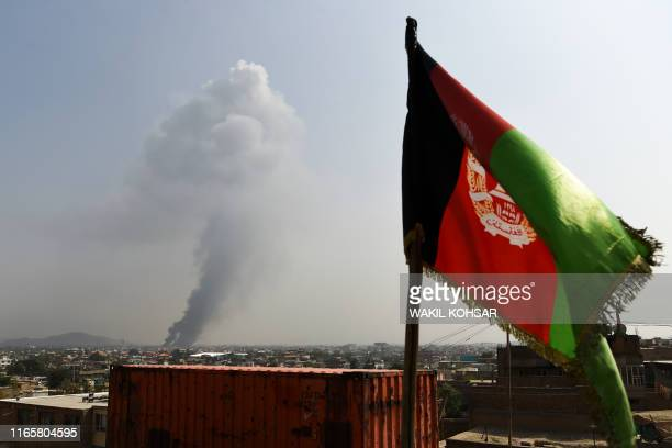 Smoke rises from the site of an attack after a massive explosion the night before near the Green Village in Kabul on September 3, 2019. - A massive...