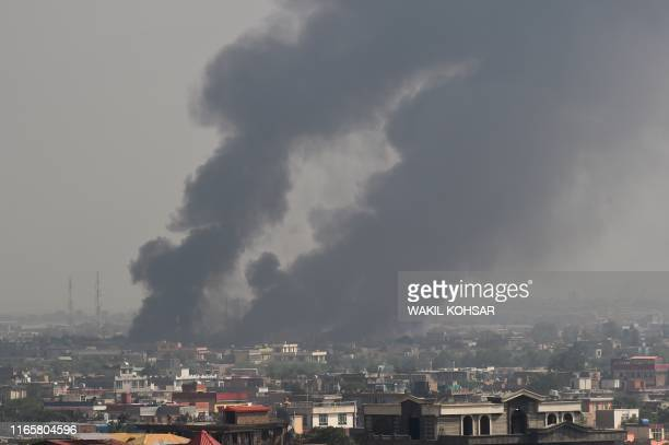TOPSHOT Smoke rises from the site of an attack after a massive explosion the night before near the Green Village in Kabul on September 3 2019 A...