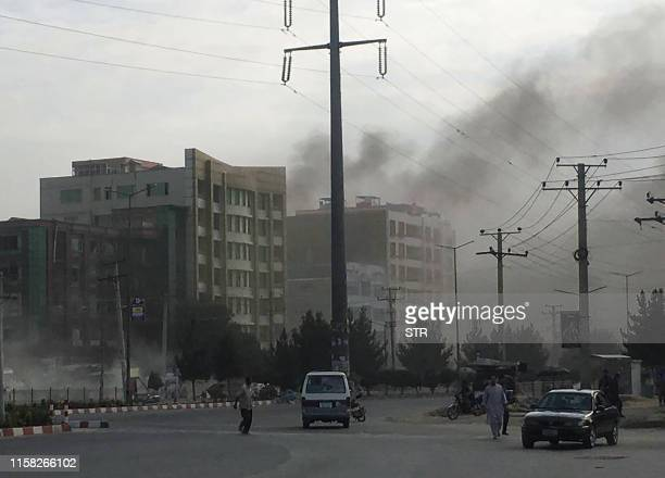 Smoke rises from the site of an attack targeting the Kabul office of the running mate of Afghan President Ashraf Ghani in Kabul on July 28 2019 At...
