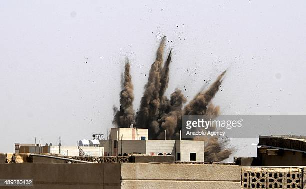 Smoke rises from the site of Saudiled air strikes targeting a military academy seized by Houthi militants in Sanaa Yemen on September 20 2015