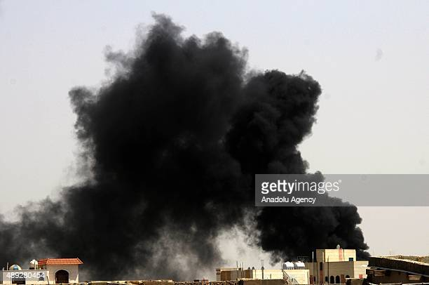 Smoke rises from the site of Saudi-led air strikes targeting a military academy seized by Houthi militants in Sanaa, Yemen on September 20, 2015.