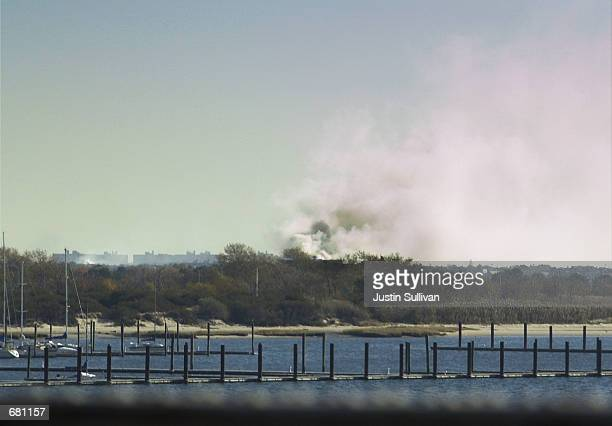 Smoke rises from the site where American Airlines Flight 587 crashed November 12 2001 in Rockaway Beach New York City The plane carrying 255 people...