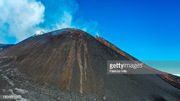 Smoke rises from the south-east crater of Etna, in a moment of apparent quiet, photographed from an altitude of 2,900 m on March 02, 2021 in Catania,...