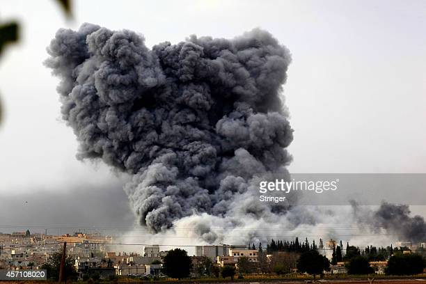 Smoke rises from the Syrian town of Kobani, seen from near the Mursitpinar border crossing on the Turkish-Syrian border in the southeastern town of...