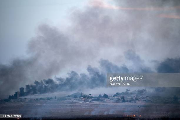 TOPSHOT Smoke rises from the Syrian town of Tal Abyad in a picture taken from the Turkish side of the border in Akcakale on October 10 on the second...