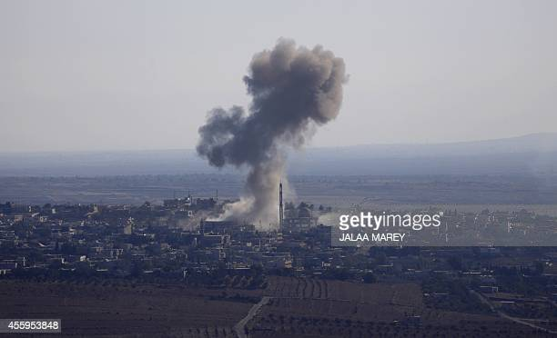 Smoke rises from the Syrian village of Jubata alKhashab after it was bombed by a Syrian fighter jet on September 23 moments before a Syrian jet was...