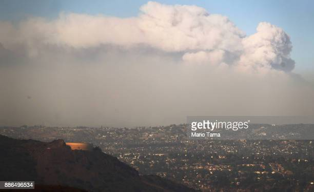 Smoke rises from the Thomas Fire on December 5 2017 in Ventura California Around 45000 acres have burned with 150 structures destroyed in the fire...