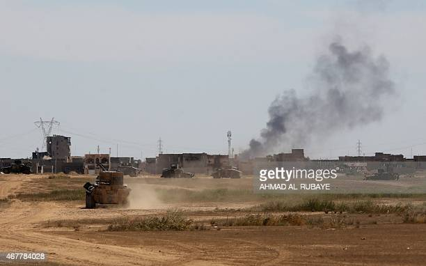 Smoke rises from the western outskirts of the Iraqi city of Tikrit on March 27 during an operation by Iraqi government forces to retake the city from...