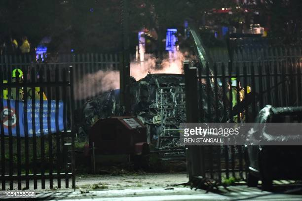 TOPSHOT Smoke rises from the wreckage of a helicopter that crashed in a car park outside Leicester City Football Club's King Power Stadium in...
