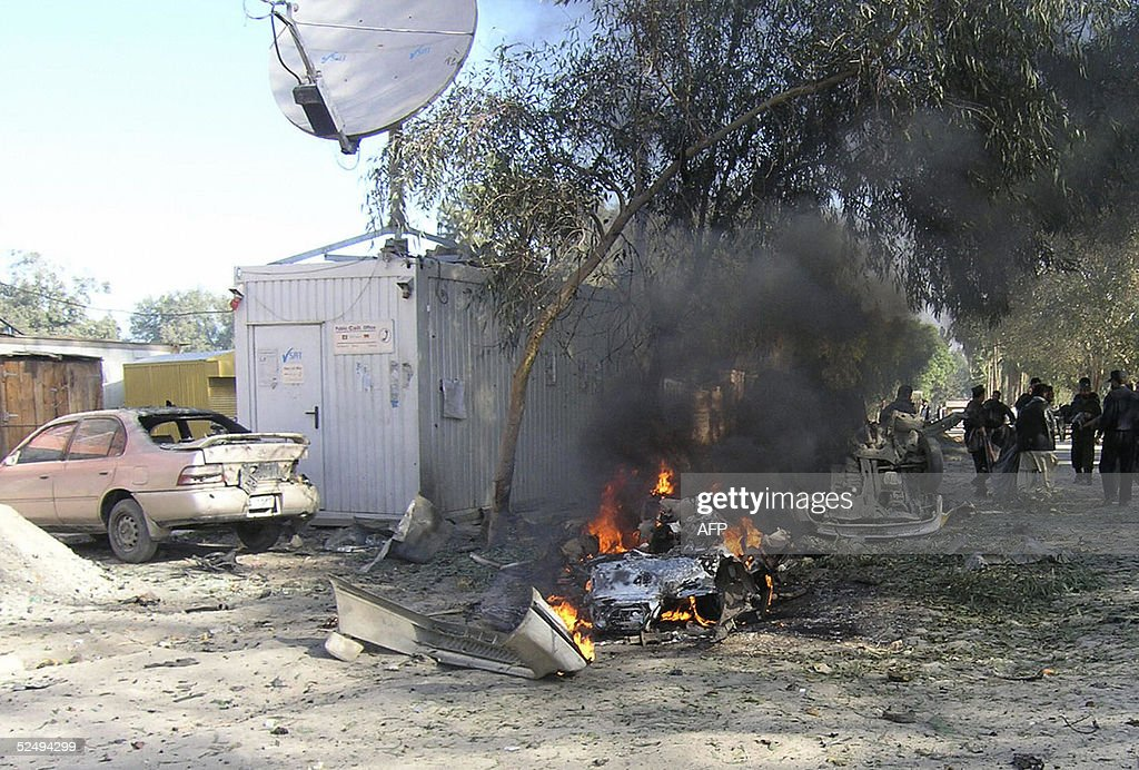 Smoke rises from the wreckage of the car : News Photo