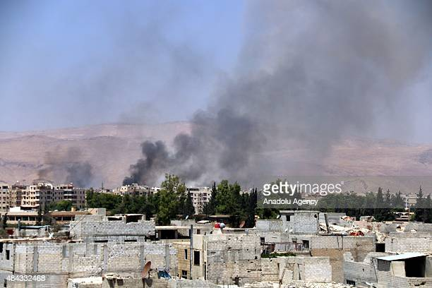 Smoke rises in Haresta district of east Ghouta Damascus after Asad Regime Forces stage an airstrike on August 17 2015