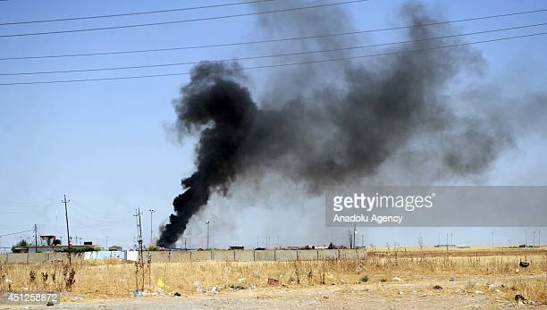 Smoke rises in Karakus district of Iraq's Mosul as the clashes keep going between Iraqi Kurdish Peshmerga forces and the Islamic State of Iraq and...
