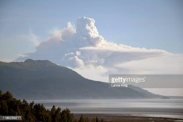 Smoke rises in the air from an unidentified source southwest of Anchorage near the Cook Inlet area at 649 pm on July 4 2019 in Anchorage Alaska This...