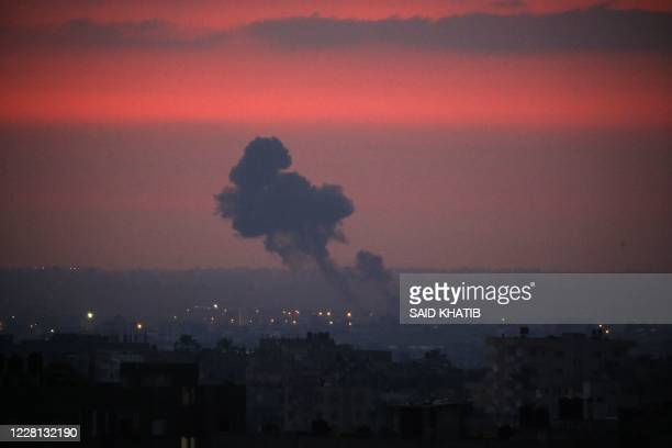 Smoke rises in the distance after war planes belonging to the Israeli army carried out airstrikes over Khan Yunis, in the Southern Gaza Strip early...