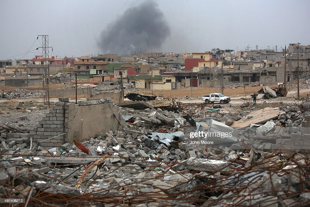 Smoke rises in the distance, on a day when ISIL fighters fired multiple Katyusha rockets at Kurdish Peshmerga forces occupying the ruins of the town on November 16, 2015 in Sinjar, Iraq. The Kurds, with the aid of months of U.S.-led coalition airstrikes, liberated the town from ISIL extremists, known in Arabic as Daesh, in recent days. Although the battle was deemed a major victory, much of the city lay in complete ruins and is still vulnerable to attack.