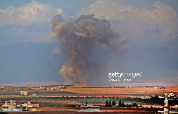 Smoke rises in the Syrian village of Kafr Ain in the southern countryside of Idlib province after an airstrike on September 7 2018 The presidents of...