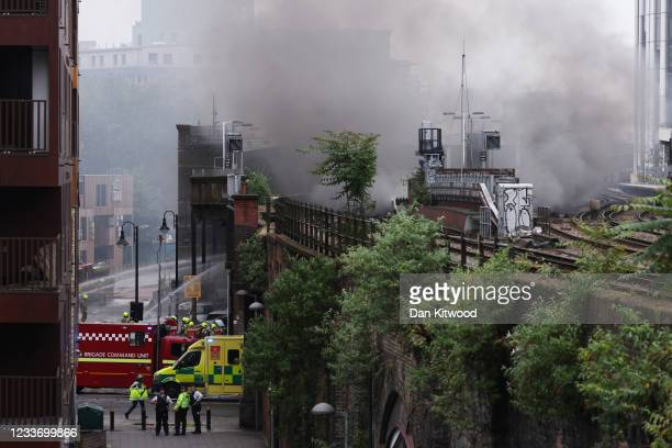 Smoke rises into the sky as firefighters tackle a fire nearby the Elephant & Castle Rail Station on June 28, 2021 in London, England. London Fire...