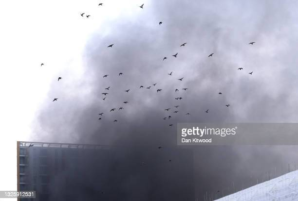 Smoke rises into the sky from a fire nearby the Elephant & Castle Rail Station on June 28, 2021 in London, England. London Fire Brigade has said that...