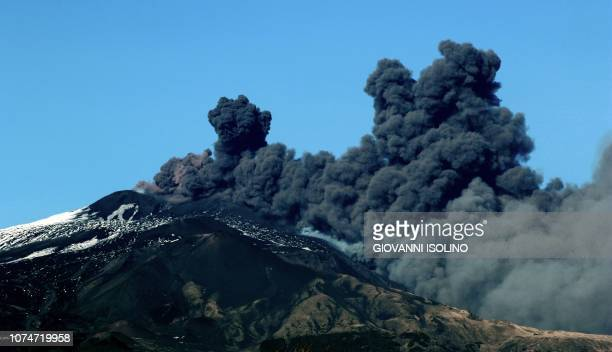 TOPSHOT Smoke rises near the city of Catania during an eruption of the Mount Etna one of the most active volcanoes in the world on December 24 2018